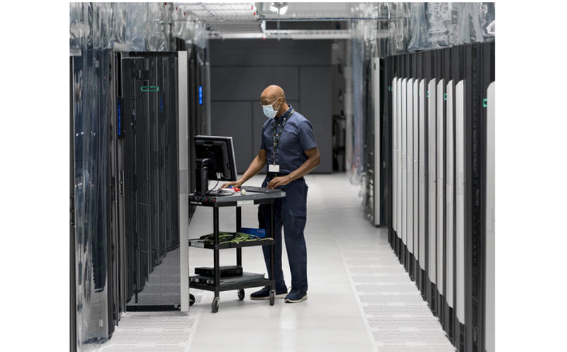 a man is seen working in a server room