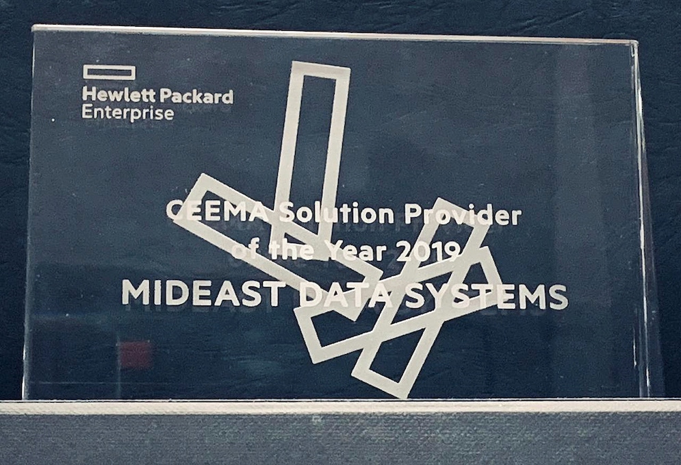 shows a glass award with lettering on it spelling out CEEMA solution provider of the Year 2019, Mideast Data Systems