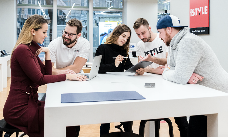 shows a group of people working together across a table