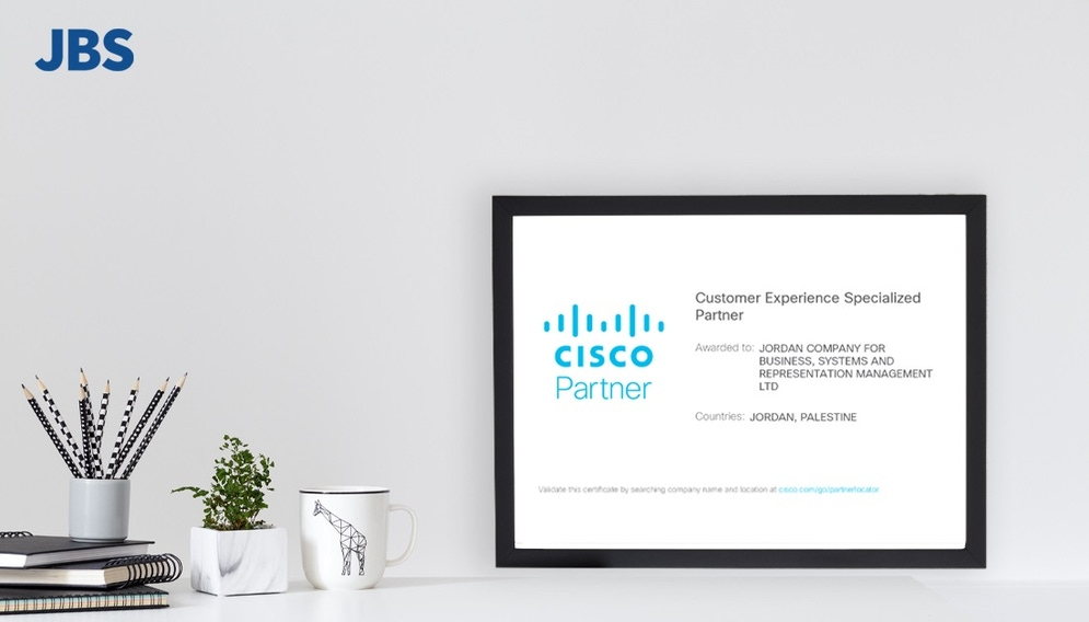a Cisco logo is seen on a screen in a domestic setting