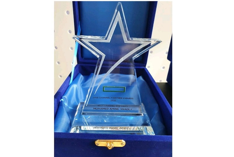 shows an award made in glass in a blue velvet box