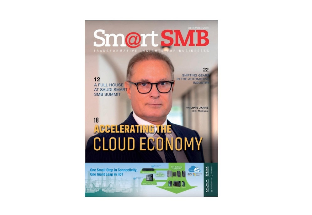 shows a magazine cover with a man in a suit wearing glasses
