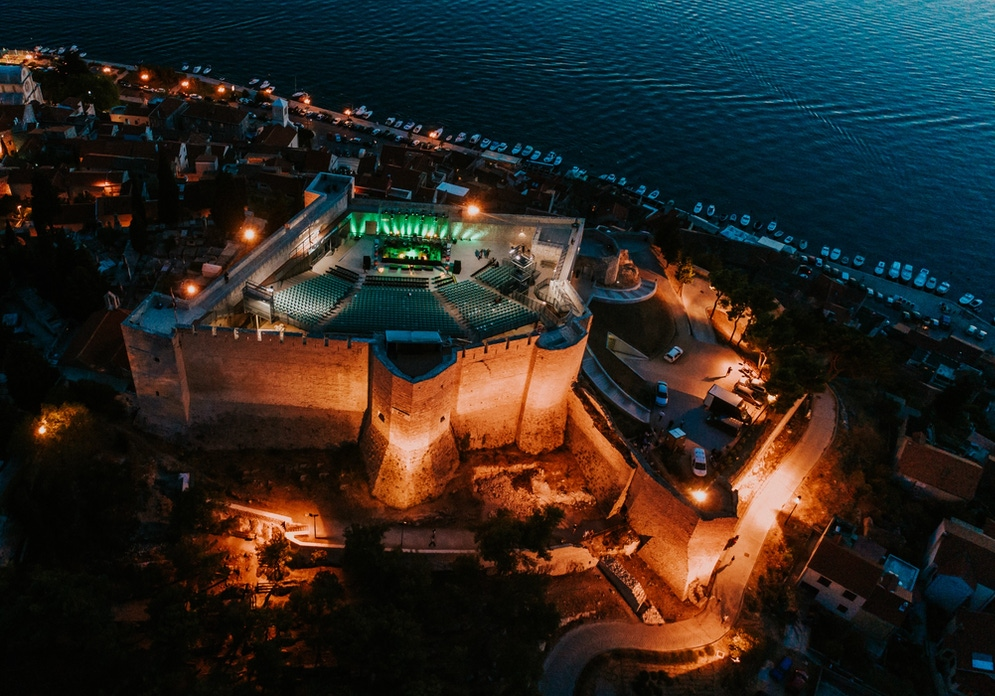 shows a castle seen from above at night