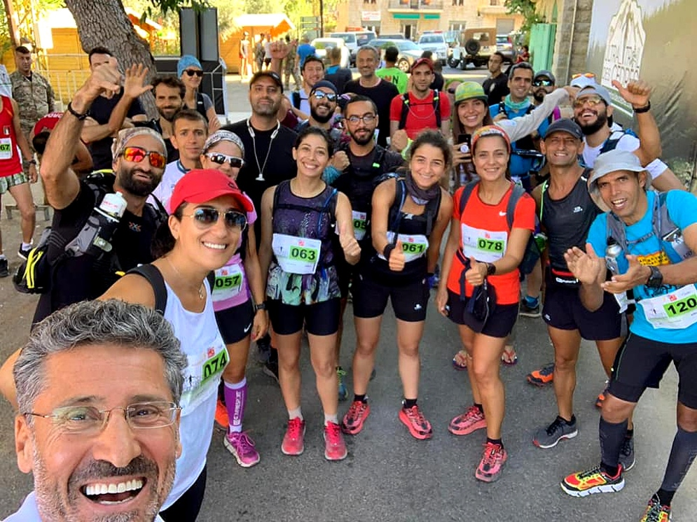 shows a group of smiling runners after an event