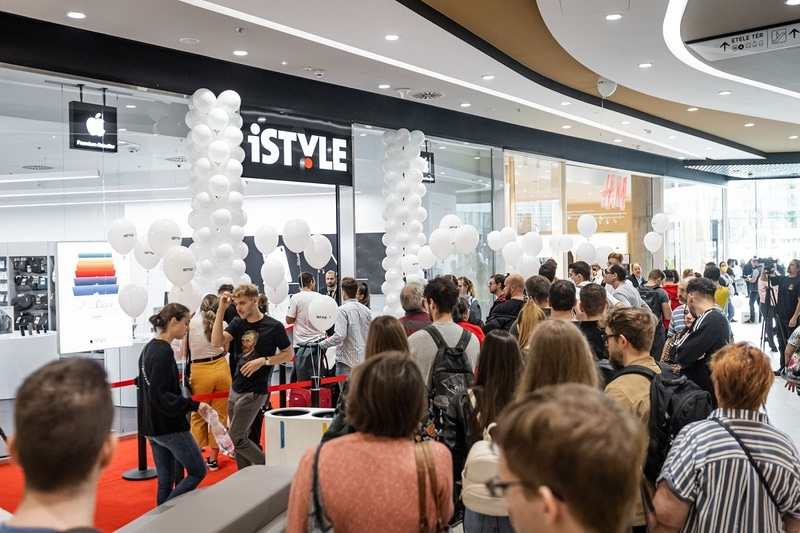 a big crowd is seen outside a high-tech store as it opens.