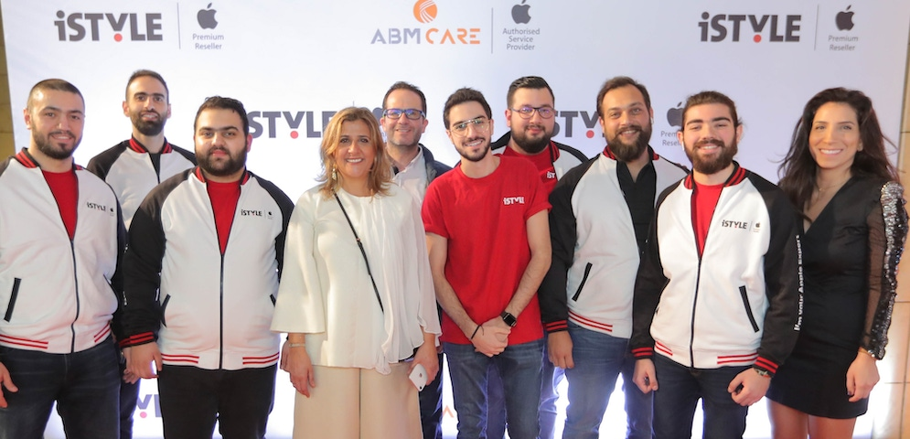 shows a group of people on a red carpet at a retail launch